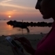 Female Using Smartphone On Beach Against Sunset - VideoHive Item for Sale