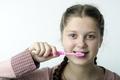 Cute girl brushing teeth on white - PhotoDune Item for Sale