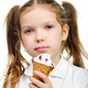 Joyful child girl eats ice- cream isolated - PhotoDune Item for Sale