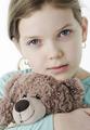 Portrait of pretty little girl holding teddy bear on white - PhotoDune Item for Sale