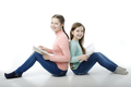 Little girls read books back to back on white - PhotoDune Item for Sale