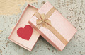 Red heart in gift box on grunge wood background in vintage style - PhotoDune Item for Sale
