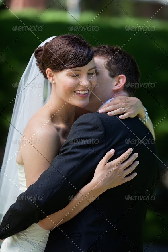 Groom Kisses His Bride - Stock Photo - Images