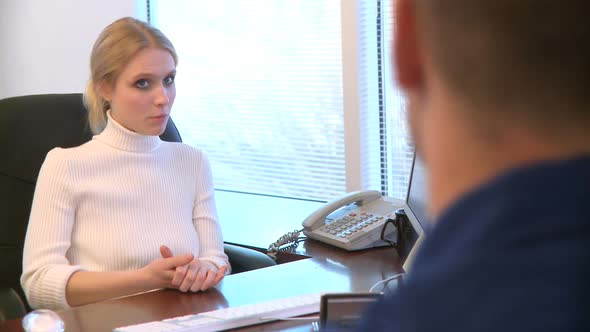 Professional Female Speaks With A Co-Worker 6 Of 12