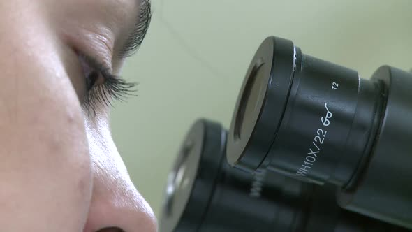 VideoHive Closeup Of Eyes Looking Through Microscope 2 Of 3 10845227