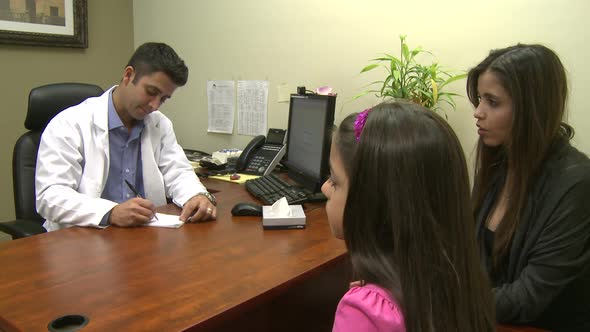 VideoHive Male Doctor Consults With Mother And Daughter 5 Of 7 10846377