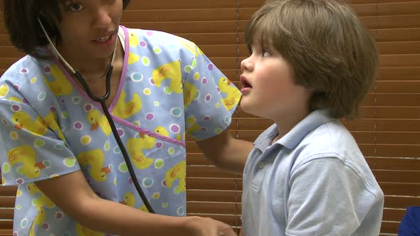 VideoHive Young Boy At Doctors Office 10846411