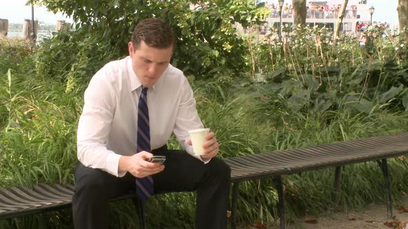 Businessman Sits On Bench Talking On Phone 3 Of 3