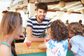 Man Making Children Fruit Smoothies In Restaurant - PhotoDune Item for Sale