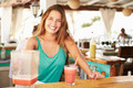 Woman In Restaurant Making Fruit Smoothies - PhotoDune Item for Sale