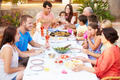 Large Family Group Enjoying Meal On Terrace Together - PhotoDune Item for Sale