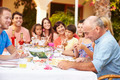 Large Family Group Celebrating Birthday On Terrace Together - PhotoDune Item for Sale