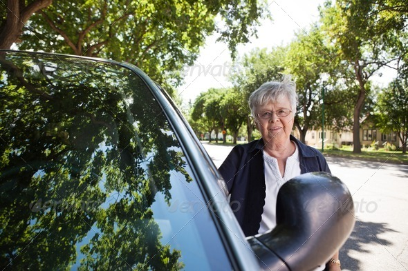 Senior woman Standing by Car - Stock Photo - Images