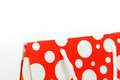 Red shopping bag with polka dot design closeup isolated on white - PhotoDune Item for Sale