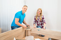 Couple Assembling Wooden Furniture - PhotoDune Item for Sale
