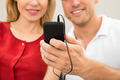 Couple Listening To Music With Mobile Phone - PhotoDune Item for Sale
