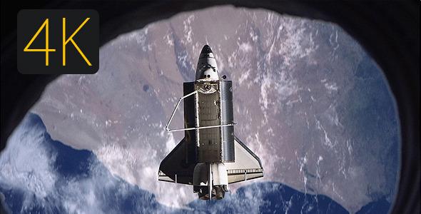Shuttle Flying Over The Earth