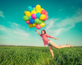 Woman with toy balloons in spring field - PhotoDune Item for Sale
