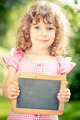 Child holding blackboard blank - PhotoDune Item for Sale