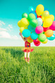 Child with toy balloons in spring field - PhotoDune Item for Sale
