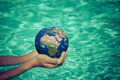 Child holding Earth planet in hands - PhotoDune Item for Sale