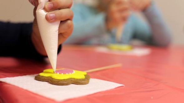 Woman Decorates Cookies