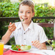 Child eating salad at a cafe - PhotoDune Item for Sale