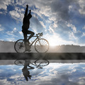 cyclist riding a road bike at sunset - PhotoDune Item for Sale