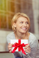 Joyful woman holding a Valentines gift - PhotoDune Item for Sale