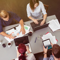 Friends in a Meeting with Computers and Reports - PhotoDune Item for Sale
