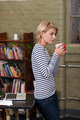 Gorgeous woman with coffee leaning on table - PhotoDune Item for Sale
