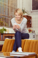 Young woman reading her text messages - PhotoDune Item for Sale