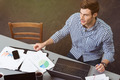 Handsome man working at a table in the office - PhotoDune Item for Sale