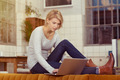 Woman with Laptop Sitting on the Table Behind Sofa - PhotoDune Item for Sale