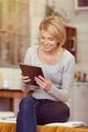Young Happy Woman Looking at her Tablet on Hand - PhotoDune Item for Sale
