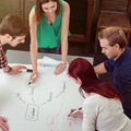 Friends Brainstorming at Table Using Mind Map - PhotoDune Item for Sale