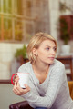 Observant young woman with a cup of coffee - PhotoDune Item for Sale