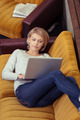 Young woman relaxing at home with her laptop - PhotoDune Item for Sale