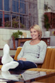 Attractive young woman relaxing at home - PhotoDune Item for Sale