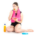 Front view of sitting woman with purple towel eating fresh fruits - PhotoDune Item for Sale