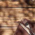 Empty board with fork and knife on wooden table - PhotoDune Item for Sale