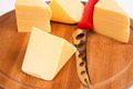 Sliced cheese on the board in the kitchen - PhotoDune Item for Sale