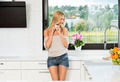 informal girl , drinking coffee in kitchen - PhotoDune Item for Sale