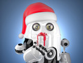 Cute robot with santa's hat holding gift box. Technology concept - PhotoDune Item for Sale