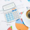 Coffee cup and calculator over financial documents - studio shot - PhotoDune Item for Sale