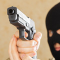 Man in black mask holding gun and ready to use it - PhotoDune Item for Sale