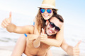 Young couple having fun at the beach - PhotoDune Item for Sale