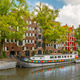 Amsterdam canal with picturesque houseboats, Holland, Netherlands - PhotoDune Item for Sale