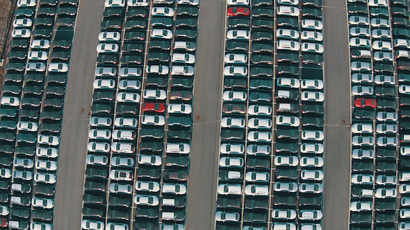 Flying Above Storage Parking Lot New Unsold Cars