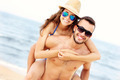 Happy couple having fun at the beach - PhotoDune Item for Sale